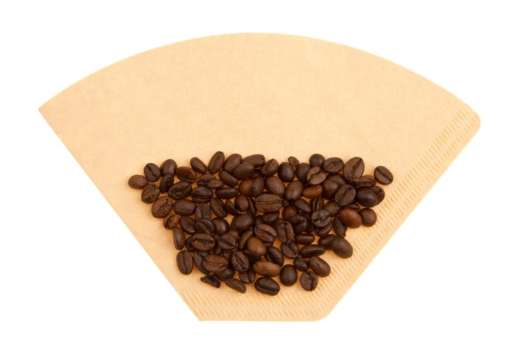 Paper filter with coffee beans
